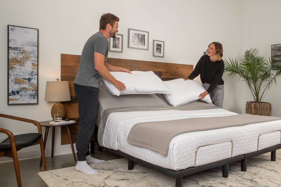 Podium Adjustable Bed Base Couple Adding Pillows | Podiumbed.ca